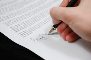 A person signing a Employment contract in australia