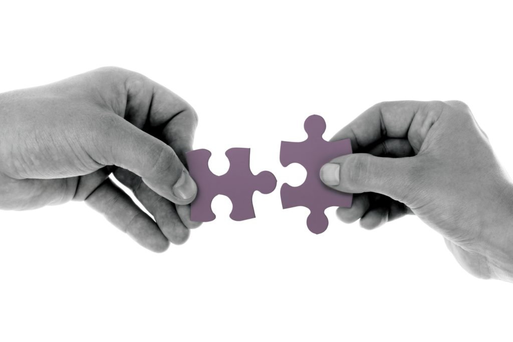 Managing Payroll In A Merger Or Acquisition two people